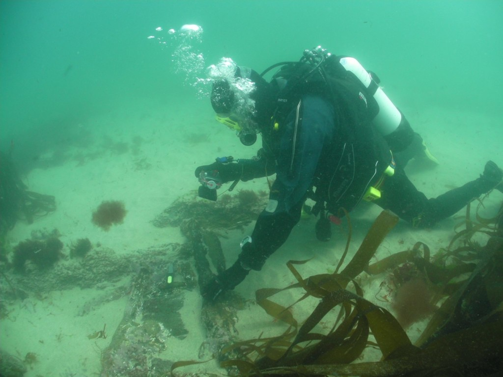 2.Archaeologist David Gibbins photographing musket barrels revealed this year on the wreck of the Schiedam (photo: Mark Milburn)