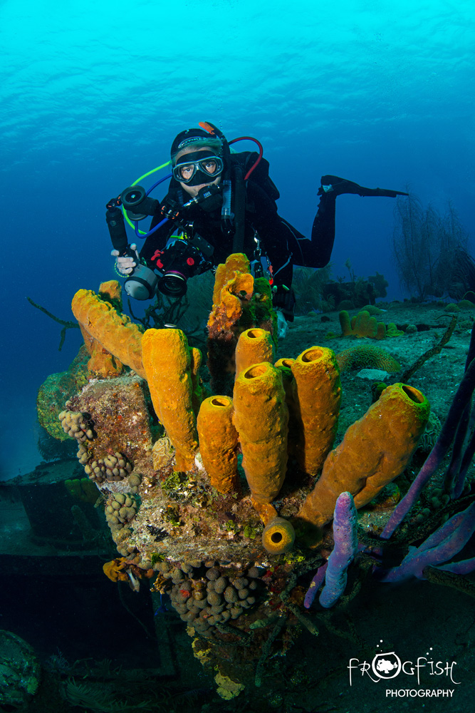 Frogfish Photography student poses for a photo on the Doc Poulson wreck