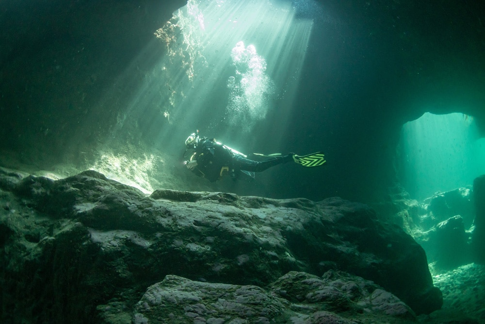 Diver in Cave, Hook Head, Co Wexford Ireland